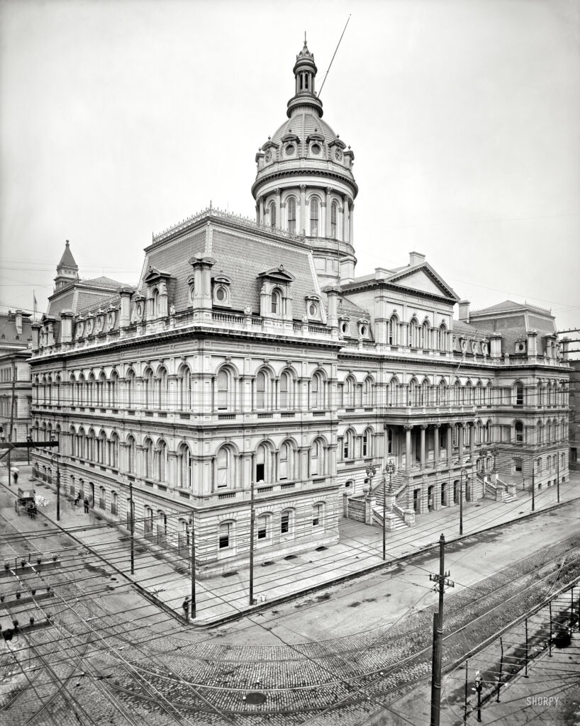 """Circa 1900. """"Baltimore City Hall."""" Rising behind a web of wires. 8x10 inch dry plate glass negative, Detroit Publishing Company."""