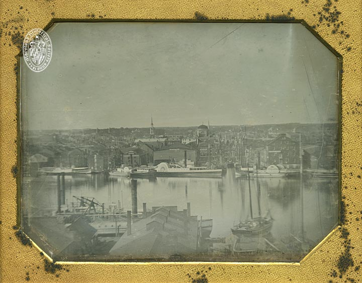 Baltimore Harbor view. Gay Street dock from Federal Hill, Baltimore. Attributed to Henry H. Clark. Full plate daguerreotype. Shows ships Herald and Juniata, Merchant's Exchange building (demolished ca. 1901-1902), and Second Reformed Church.