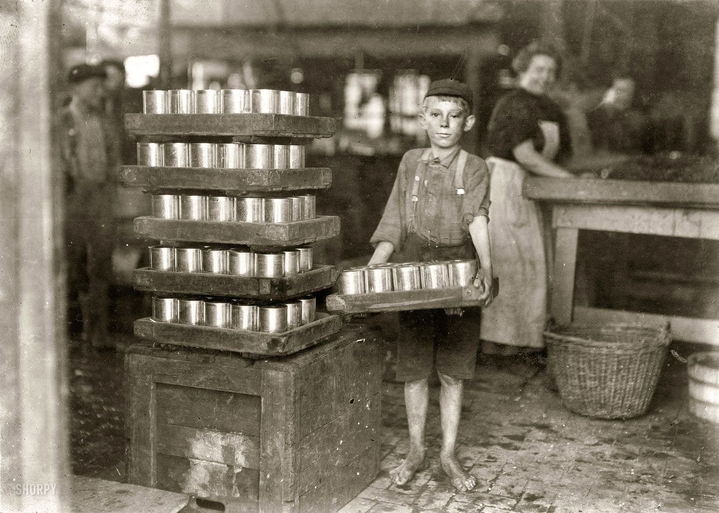Wow. Amazing Photo of Barefoot Boy at Packing Plant