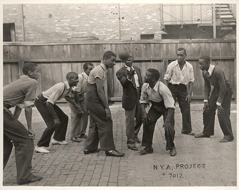 B&W photograph of the tip-off to a basketball game played as part of National Youth Administration recreation program, Baltimore, ca. 1935.