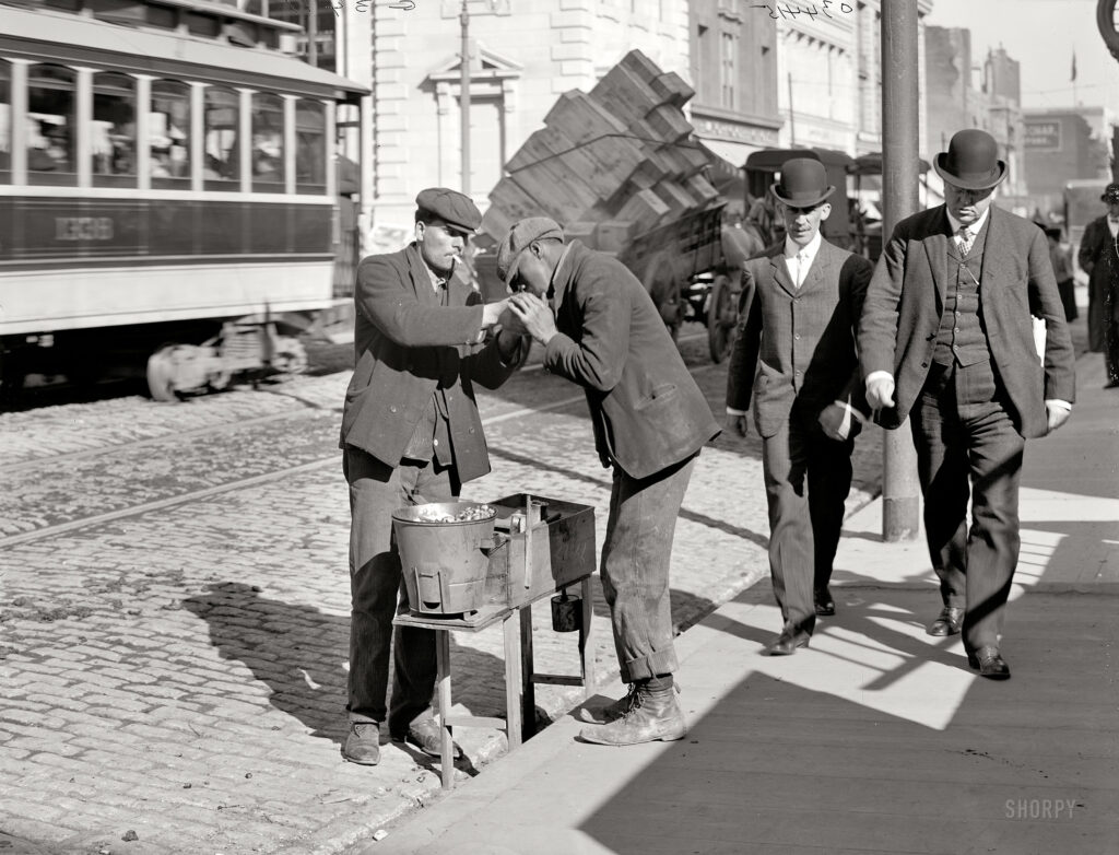 "Baltimore, Maryland, circa 1905. ""A chestnut vendor."" 8x10 inch dry plate glass negative, Detroit Publishing Company."
