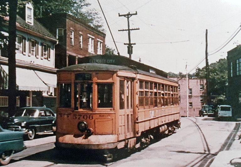 This double-ended, 1918 vintage Baltimore Traction Company Brill streetcar has just begun its in-bound journey from Ellicott City, Maryland, heading east to Baltimore on the No. 9 line. Positioned here at 8304 Main Street, car 5706 is about to plunge down a fairly steep grade (about 5%) that bottoms out at the Patapsco River crossing seen here. It must climb a longer but less arduous slope on the other side.
