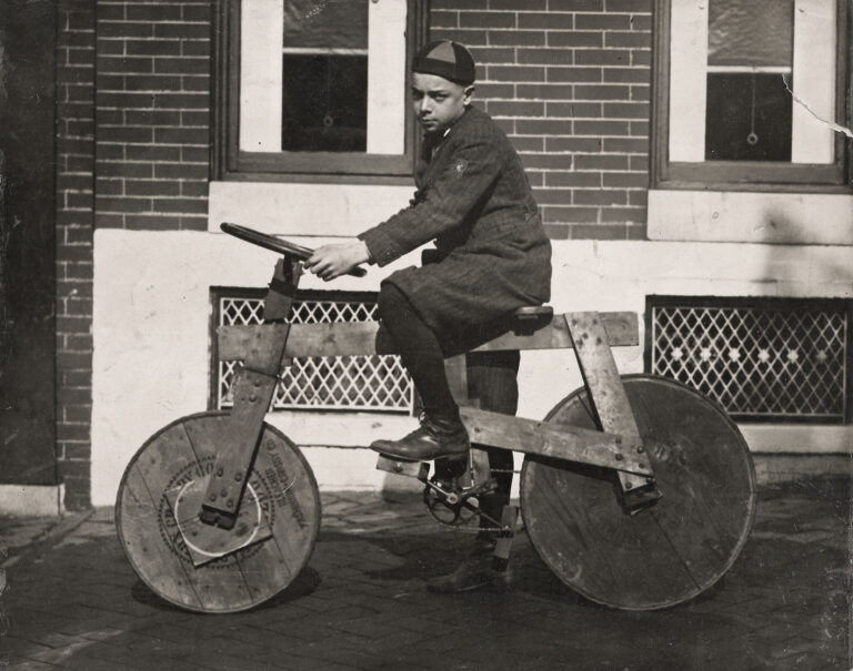 "Bernard J. ""Boompy"" Logue of 2527 E. Monument St. in Baltimore, MD, about 1920, on his home made bicycle."
