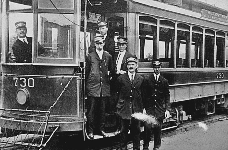 Catonsville, Maryland, C. 1915. These no-nonsense chaps manned streetcars for the Baltimore Traction company. In those days, two-man crews were the norm, with a motorman at the tiller and a conductor to collect tickets and to be the first line of customer service. The car's signage references Hillen, York, and Frederick Roads, all of which still exist today in the city of Baltimore. Without additional documentation, it's not clear exactly how a streetcar would traverse those as part of one route.
