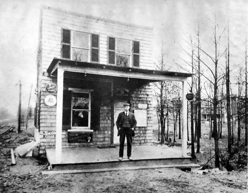 Catonsville Junction, 1910. Rudolph Diehlmann poses before his lunchroom establishment. While crying out for some landscaping, the site's amenities include a pay phone. Tracks on the left are the Baltimore Traction Company's No. 14 streetcar line, pointing east toward Baltimore.