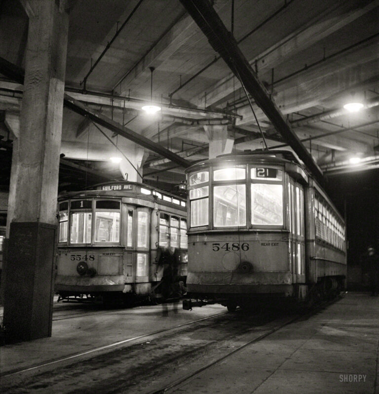 "April 1943. ""Baltimore, Maryland. Trolleys inside the Park Terminal at night."" Photo by Marjory Collins for the Office of War Information."