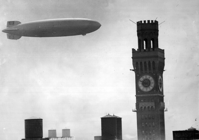 "The 804-foot-long dirigible Hindenburg, the ""Titanic of the Skies,"" soars above the Bromo-Seltzer Tower on its way to Lakehurst (N.J.) Naval Air Station on August 11, 1936. Nine months later, it would explode at Lakehurst, killing 35 passengers and crew. (Baltimore Sun)"