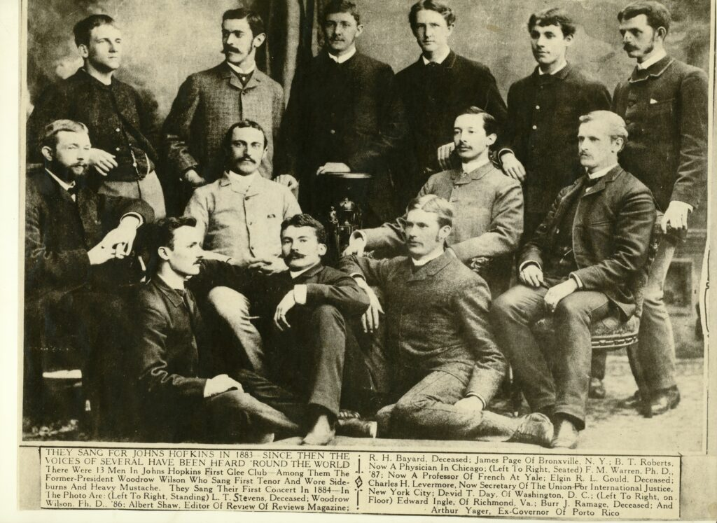There were thirteen men in Johns Hopkins first Glee Club, among them was Woodrow Wilson who sang first tenor. He is second from left standing in the back with heavy sideburns and mustache.