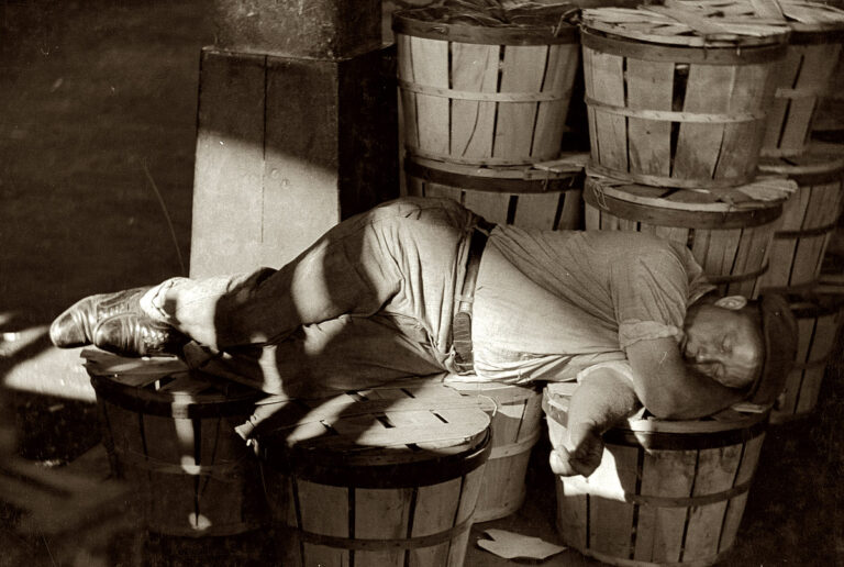 July 1938. Man sleeping in the Baltimore fish market. View full size. 35mm nitrate negative by Dick Sheldon for the Farm Security Administration.