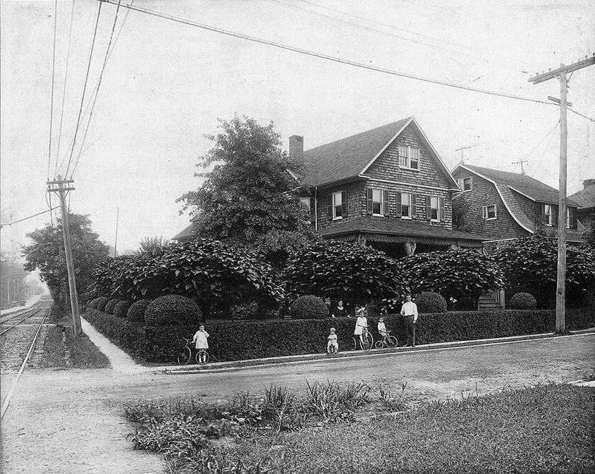 Smithwood Avenue branches off to the right while Edmondson Avenue slopes uphill on the left heading east toward the city of Baltimore. In addition to automobile traffic, Edmondson Avenue at the time accommodated the Baltimore Traction Company No. 14 trolley line. A junction for three rail lines was located immediately behind the photographer's vantage point. These houses still exist, albeit with vinyl siding applied over the handsome cedar shingles. Oh, and the streets have since been paved. Photo taken about 1925