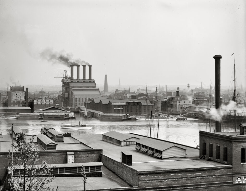 """Circa 1903. """"Baltimore from Federal Hill."""" A freight terminal (O'Donnell's Wharf) and the Patapsco flour mill. Detroit Publishing Co. glass negative."""
