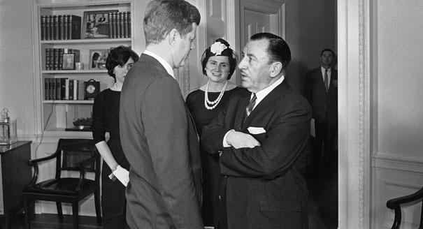 Thomas D'Alesandro Jr., former mayor of Baltimore, talks on March 28, 1961, at the White House with President John Kennedy after taking the oath to become a member of the Federal Renegotiation Board. Mrs. D'Alesandro and their daughter, Nancy (left), are in the background.