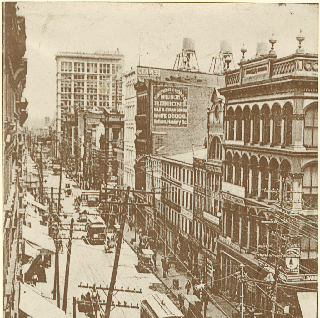 Photograph that features a view of Baltimore Street west of Hanover Street on Baltimore before the fire of 1904. Conspicuous landmarks are the Continental Building, now the Mercantile Trust Company, and the business house of Armstrong Cator & Co. west of Charles Street.