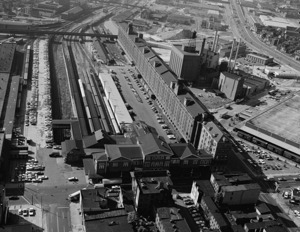 AERIAL VIEW OF STATION AND YARDS, LOOKING SOUTH - Baltimore & Ohio Railroad, Camden Station, South side of Camden Street between Eutaw & Howard Streets, Baltimore, Independent City, MD