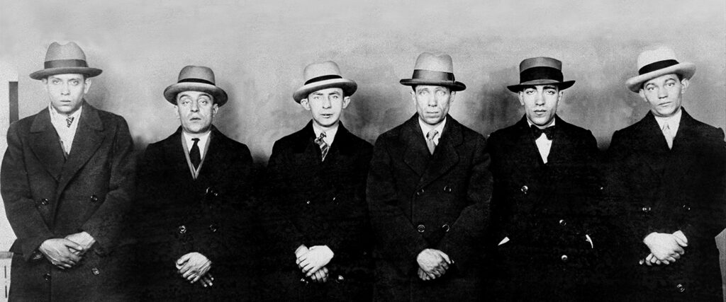 Leon Liss, Barney Mortillaro, Milton 'Shuffles' Goldberg, Louis Liss, Pasquale Chicarelli, and gang leader Richard Reese Whittemore (l. to r.) in a police lineup, after they were implicated in a jewelry heist, March 25, 1926. (NY Daily News Archive via Getty Images)